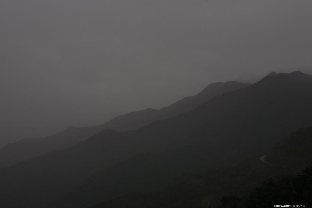 The early morning fog silhouettes the mountains of the Chiriqui Highlands, Panama.