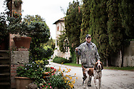 Italy, La Foce - Aldo Romagnoli walks Boby, his italian hunting dog outside the La Foce property. Mr. Romagnoli used to work as a farmer inside La Foce property.<br /> Ph. Roberto Salomone