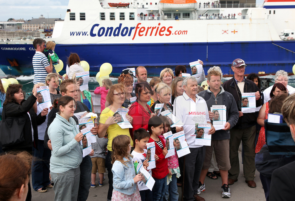 © under license to London News Pictures. 13/08/2012. PORTSMOUTH, UK. FRIENDS AND FAMILY OF CREW WAIT AT THE PORT AS HMS WESTMINSTER RETURNS TO PORTSMOUTH FROM DUBAI WITHOUT MISSING CREWMAN TIMMY MACCOLL on AUGUST 13, 2012. Picture credit: Bryan Moffat/LNP