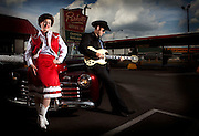 Patsy Cline as played by Heather  Parrish, left, and guitarist Billy W.H. Mason, with 1940's Ford for promotion of the Patsy Cline Production on Monday July 6, 2009 in Lexington, Ky. Photo by Mark Cornelison | Staff