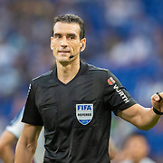 BARCELONA, SPAIN - August 18:   Referee Martinez Munuera explains a VAR ruling to the players during the Espanyol V  Sevilla FC, La Liga regular season match at RCDE Stadium on August 18th 2019 in Barcelona, Spain. (Photo by Tim Clayton/Corbis via Getty Images)