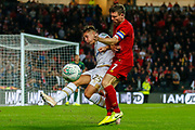 Milton Keynes Dons forward Callum Brittain (25) prevents an attack by Liverpool midfielder James Milner (7) during the EFL Cup match between Milton Keynes Dons and Liverpool at stadium:mk, Milton Keynes, England on 25 September 2019.