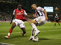 Photo: Rich Eaton.<br /> <br /> West Bromwich Albion v Arsenal. Carling Cup. 24/10/2006. Nigel Quashie right of West Brom takes on Johan Djourou of Arsenal