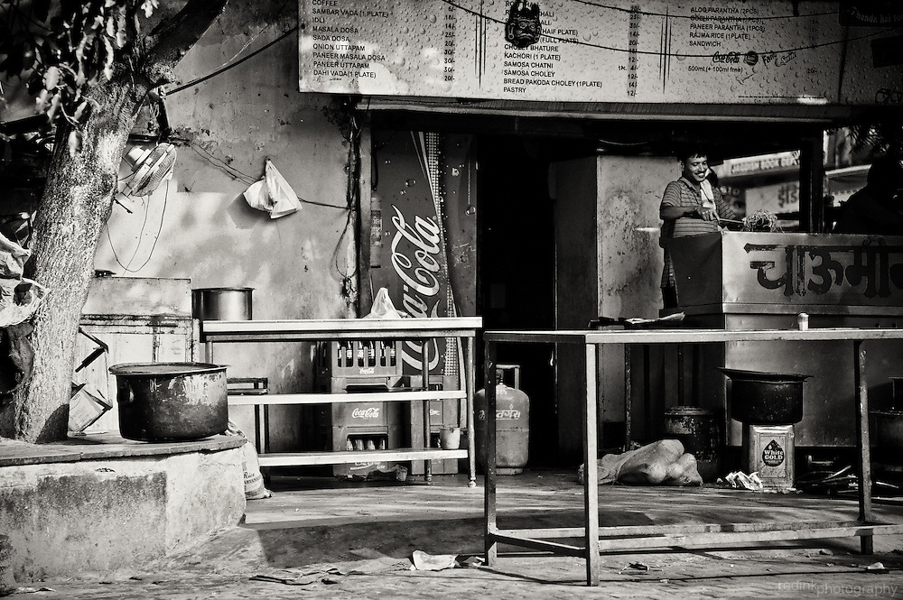 A man cooks food at a roadside restaurant. Converted to black and white using Silver Efex Pro. New Delhi, India
