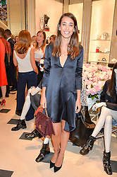 LAURA JACKSON at a cocktail party to mark the opening of the House of Dior, the United Kingdom's largest and premier Dior boutique at 160-162 New Bond street, London on 8th June 2016.