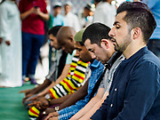 15 JUNE 2018 - SEOUL, SOUTH KOREA: Men pray in Seoul Central Mosque on Eid al Fitr, the Muslim Holy Day that marks the end of the Holy Month of Ramadan. There are fewer than 100,000 Korean Muslims, but there is a large community of Muslim immigrants in South Korea, most in Seoul. Thousands of people attend Eid services at Seoul Central Mosque, the largest mosque in South Korea.   PHOTO BY JACK KURTZ