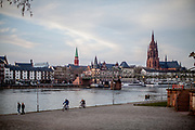 """Germany banned gatherings of more than 2 people called """"social distancing"""" because of the coronavirus. The shore of river Main in Frankfurt is very empty on a - normally very busy - Thursday evening."""