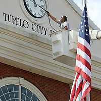 Donald Duffie, a Public Works Employee with the City of Tupelo, pressure washes City Hall at Fairpark in Tupelo Thursday. The washing is a regular maintenance item in keeping the building clean and the job will last a couple of days.