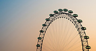 The sun rises behind the London Eye in London, England on May 24, 2012.