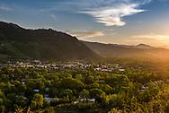 The sun sets over Aspen, Colorado as viewed from Smuggler Mountain.
