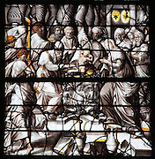 The Circumcision of Christ in the temple, from the Life of the Virgin and the Childhood of Christ grisaille stained glass window with silver and gold on white glass, 1545, by the School of Fontainebleau, in the South chapel choir of the Collegiate Church of Saint-Gervais-Saint-Protais, built 12th to 16th centuries in Gothic and Renaissance styles, in Gisors, Eure, Haute-Normandie, France. The church was consecrated in 1119 by Calixtus II but the nave was rebuilt from 1160 after a fire. The church was listed as a historic monument in 1840. Picture by Manuel Cohen