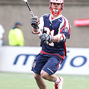 Will Mangan #21 of the Boston Cannons looks to pass the ball during the game at Harvard Stadium on April 27, 2014 in Boston, Massachusetts. (Photo by Elan Kawesch)