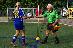 Soccer Linesman Aubrey Cashman, right, hands off the ball for a corner kick during a soccer match between Lexington Catholic and Henry Clay, Tuesday, Aug. 13, 2013 at Lexington Catholic Soccer/Football Stadium in Lexington. Photo by Jonathan Palmer