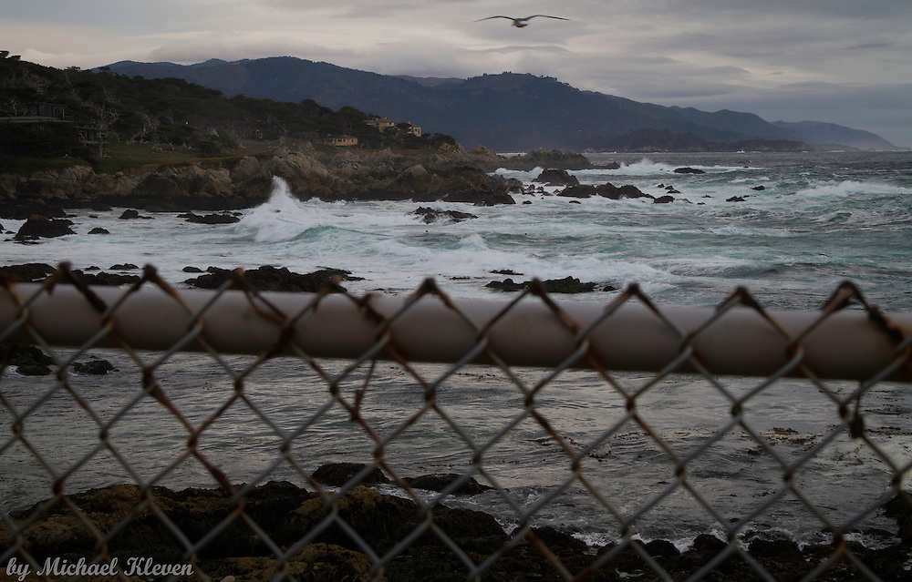 A gull soars over the crashing waves at Sunset Point on 17  Mile Drive
