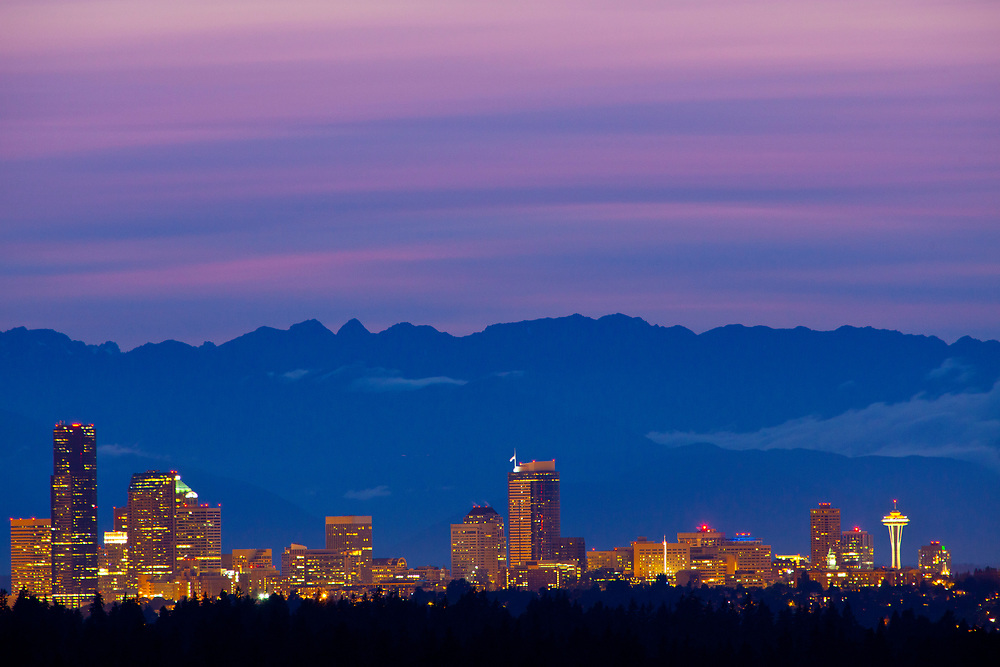 United States, Washington, Seattle, downtown skyline with Space Needle and Olympic Mountains at sunset