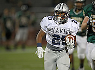 Xavier's Brendan Miller (25) on a run during their game at Kingston Stadium in Cedar Rapids on Friday, September 27, 2013.