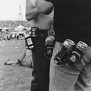 Men with cans of Stella and Strongbow attached to their trousers, Rock and Blues festival