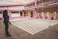 """ANA MARIA CAMPOS II PRISON, MARACAIBO. - December 2018<br /> <br /> A group of female detainees warms up before doing sports guarded by a custodian inside a """"closed"""" prison - or a center of feminine formation, how the ministry of the popular power for the prison service calls it -. Only the already judged female detainees can go to this kind of prison. In this facilities they are not overcrowded, they have food, water and medical attention. They receive classes, do sports and cook. These women are not allowed to make or receive phone calls and the visitation days are only once a month."""