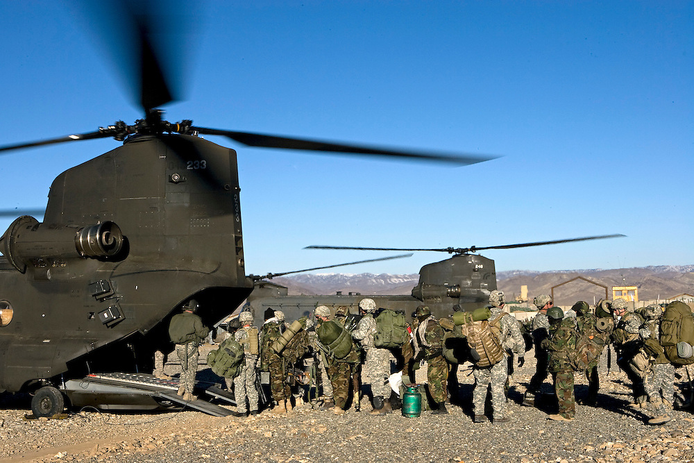 Afghan and US troops board a CH-47 Chinook helicoper ready to deploy to the village of Rebat as part of a humanitarian assistance mission called Operation 'Winterstand'. FOB Bermel, Paktika Province, Afghanistan on the 18th of January 2008.