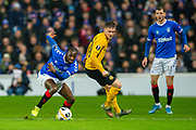 Glen Kamara (#18) of Rangers FC looks to run past Michel Aebischer (#20) of BSC Young Boys during the Europa League Group G match between Rangers FC and BSC Young Boys at Ibrox Park, Glasgow, Scotland on 12 December 2019.