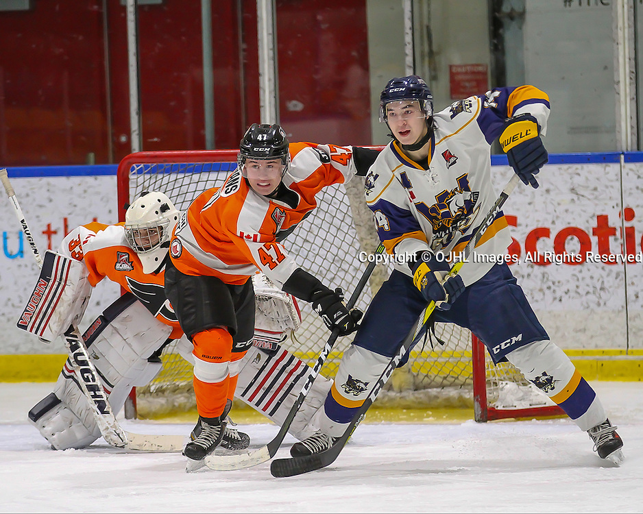 WHITBY, ON - DEC 18,  2016: Ontario Junior Hockey League game between Orangeville and Whitby, Aidan Timmermans #47 of the Orangeville Flyers battles for position in front of the net against Tiger McDonald #14 of the Whitby Fury while goaltender Nathan Torchia #33 of the Orangeville Flyers watches the play.<br /> (Photo by Ray MacAloney / OJHL Images)