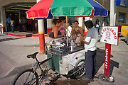 Street vendor selling drinks from his cart, Tena, Ecuador