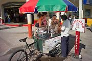 Street vendor selling drinks from his cart, Tena, Ecuador