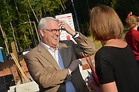 Chancellor Randy Woodson greets guests at the Build-A-Block Habitat for Humanity project ceremony.