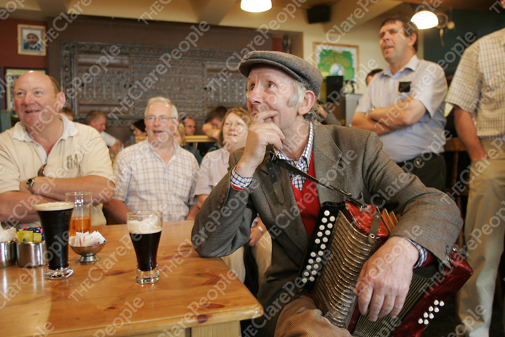 Musician Mattie Vaughan from Newmarket on Fergus Co. Clare listens to a Storyteller during the 33rd Willie Clancy Summer School in Milltown Malbay Co. Clare.  <br /> Pic.Brian Gavin/Press 22