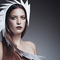 Caucasian female model wearing unusual white headdress