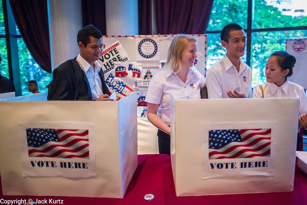 07 NOVEMBER 2012 - BANGKOK, THAILAND:   Thai and expatriot high school students participate in a mock election set up by the US Embassy at the Embassy's election watch party in Bangkok. US President Barack Obama won a second term Tuesday when he defeated Republican Mitt Romney. Preliminary tallies gave the President more than 300 electoral votes, well over the 270 needed to win. The election in the United States was closely watched in Thailand, which historically has very close ties with the United States. The American Embassy in Bangkok sponsored an election watching event which drew thousands to a downtown Bangkok hotel. American Democrats in Bangkok had their own election watch party at a restaurant in Bangkok.     PHOTO BY JACK KURTZ