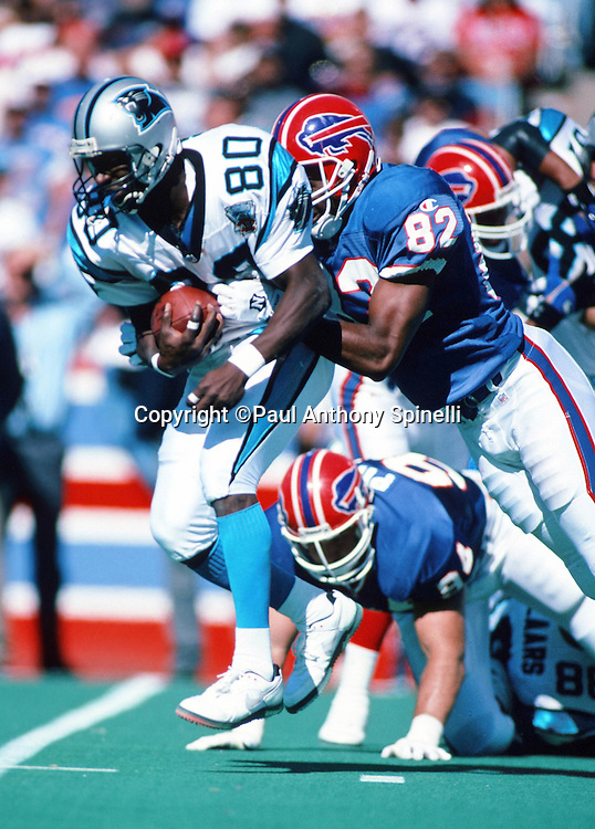 Buffalo Bills wide receiver and special teams player Chris Brantley (82) tackles Carolina Panthers wide receiver Dwight Stone (80) during the NFL football game against the Carolina Panthers on Sept. 10, 1995 in Orchard Park, N.Y. The Bills won the game 31-9. (©Paul Anthony Spinelli)