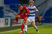 Bristol City midfielder Sammie Szmodics (17) battles for possession with Queens Park Rangers midfielder Matthew Smith (6) during the EFL Cup match between Queens Park Rangers and Bristol City at the Kiyan Prince Foundation Stadium, London, England on 13 August 2019.