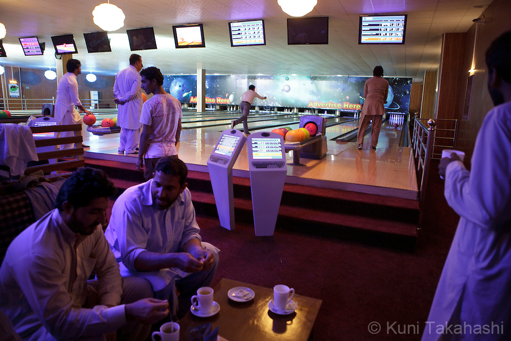 Afghans play bowling at a bowling alley, The Strikers, in Kabul on May 4, 2012. The country's first bowling alley was opened in October 2011 by Afghan woman Meena Rahmani to give youths an outlet for entertainment, something that is rare in this war-stricken country. .(Photo by Kuni Takahashi)