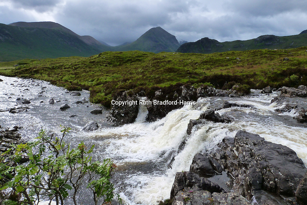 Druim na Ruaige, Belig, Marsco &amp; waterfalls on the Allt Dearg Mor Gleann Bhreatail (Glen Brittle), near Sligachan, Isle of Skye, during a rain storm. The river levels are so swollen with rainwater that they produce spectacular falls all along the route and the Glenbrittle path was also a minor stream! <br />