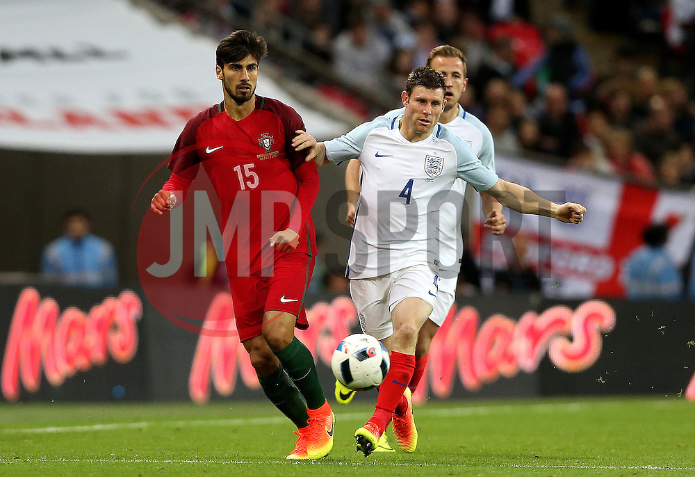 James Milner of England closes down Andre Gomes of Portugal - Mandatory by-line: Robbie Stephenson/JMP - 02/06/2016 - FOOTBALL - Wembley Stadium - London, United Kingdom - England v Portugal - International Friendly