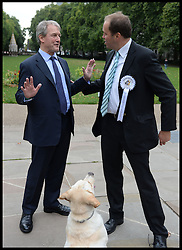 Secretary of State for Environment Owen Paterson (left) and David Burrowes and his dog Cholmeley take part in the Westminster Dog of the Year 2013 with his dog Noodle. London, United Kingdom. Thursday, 10th October 2013. Picture by Andrew Parsons / i-Images