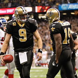 November 28, 2011; New Orleans, LA, USA; New Orleans Saints quarterback Drew Brees (9) celebrates with wide receiver Devery Henderson (19) after scoring a touchdown during the third quarter of a game at the Mercedes-Benz Superdome. The Saints defeated the Giants 49-24. Mandatory Credit: Derick E. Hingle-US PRESSWIRE