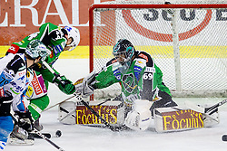 Puck in front of Matija Pintaric (HDD Tilia Olimpija, #69) during ice-hockey match between HDD Tilia Olimpija and EHC Liwest Black Wings Linz at second match in Semifinal  of EBEL league, on March 8, 2012 at Hala Tivoli, Ljubljana, Slovenia. (Photo By Matic Klansek Velej / Sportida)