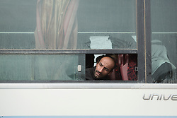 Licensed to London News Pictures. 10/11/2016. Mosul, Iraq. An Iraqi man looks from a bus window for a friend as he and other families, escaping from areas within the city where fighting between Iraqi Security Forces and Islamic State militants is taking place, wait to be evacuated by the Iraqi Army from the city's Gogjali District.<br /> <br /> The battle to retake Mosul, which fell June 2014, started on the 16th of October 2016 with Iraqi Security Forces eventually reaching the city on the 1st of November. Since then elements of the Iraq Army and Police have succeeded in pushing into the city and retaking several neighbourhoods allowing civilians living there to be evacuated - though many more remain trapped within Mosul. Photo credit: Matt Cetti-Roberts/LNP