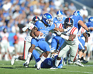 Kentucky's CoShik Williams (26) is tackled for loss by Ole Miss' Ralph Williams (44) at Commonwealth Stadium in Lexington, Ky. on Saturday, November 5, 2011. ..