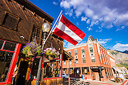 Flag and flower basket, downtown Telluride, Colorado USA