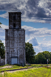 Grain elevator in Topeka Illinois sits alongside a set of railroad tracks