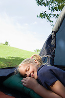 Girl pretending to sleep with a smile in a tent