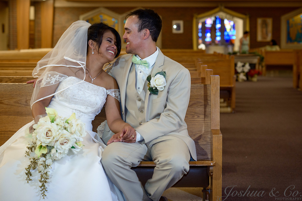 Griffin and Anna Marie Campbell are married at St. Bernadette Catholic Parish in Lakewood, Colo., on Saturday, May 27, 2017. <br /> <br /> Photo by Joshua Lawton
