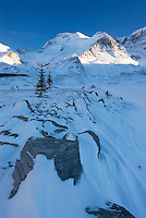 Mount Athabasca 3,491 m (11,453 ft) in winter seen from the glacial plain of the SunwaptaRiver, Jasper National Park Alberta Canada