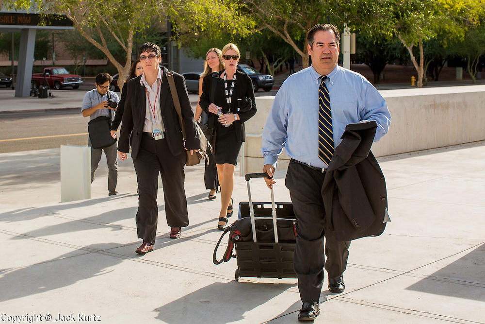 """19 JULY 2012 - PHOENIX, AZ:  TOM LIDDY, attorney for Maricopa County Sheriff Joe Arpaio walks into the courthouse on the first day of a class action lawsuit, Melendres v. Arpaio in Phoenix Thursday. The suit, brought by the ACLU and MALDEF in federal court against Maricopa County Sheriff Joe Arpaio, alleges a wide spread pattern of racial profiling during Arpaio's """"crime suppression sweeps"""" that targeted undocumented immigrants. U.S. District Judge Murray Snow granted the case class action status opening it up to all Latinos stopped by Maricopa County Sheriff's Office deputies during the crime sweeps. The case is being heard in Judge Snow's court.  PHOTO BY JACK KURTZ"""