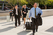 "19 JULY 2012 - PHOENIX, AZ:  TOM LIDDY, attorney for Maricopa County Sheriff Joe Arpaio walks into the courthouse on the first day of a class action lawsuit, Melendres v. Arpaio in Phoenix Thursday. The suit, brought by the ACLU and MALDEF in federal court against Maricopa County Sheriff Joe Arpaio, alleges a wide spread pattern of racial profiling during Arpaio's ""crime suppression sweeps"" that targeted undocumented immigrants. U.S. District Judge Murray Snow granted the case class action status opening it up to all Latinos stopped by Maricopa County Sheriff's Office deputies during the crime sweeps. The case is being heard in Judge Snow's court.  PHOTO BY JACK KURTZ"