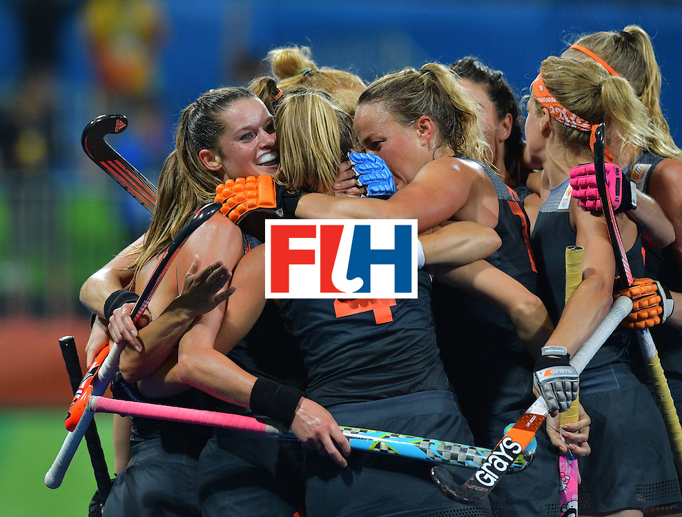 Netherland's Lidewij Welten (L) celebrates with teammates after a goal was scored during the women's field hockey China vs Netherlands match of the Rio 2016 Olympics Games at the Olympic Hockey Centre in Rio de Janeiro on August, 10 2016. / AFP / Carl DE SOUZA        (Photo credit should read CARL DE SOUZA/AFP/Getty Images)