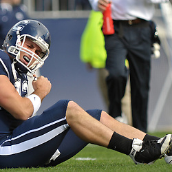 Oct 31, 2009; East Hartford, CT, USA; Connecticut quarterback Cody Endres (12) grimmaces after a hit took him out of the Big East NCAA football game between Rutgers and Connecticut at Rentschler Field.
